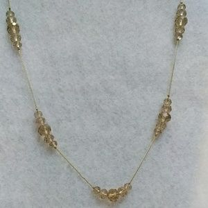 Jewelry - Gold tone necklace with champagne beaded stations